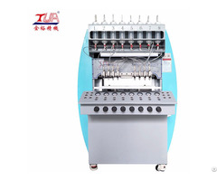 China Decorative Pvc Clothing Label Dropping Machine