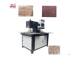 China Dongguan Jinyu Silicone Label Logo Moulding Machine Onto Garment