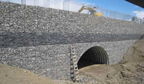 Gabion Wall Gives Retaining In River Embankment And Garden